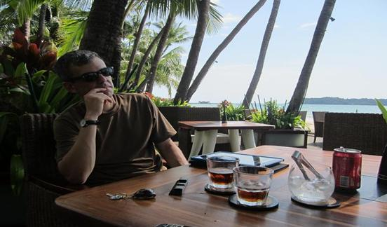 Your-editor-enjoying-the-local-rum-and-wondering-what-it-all-means